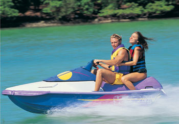 Couple enjoying jet ski on the river